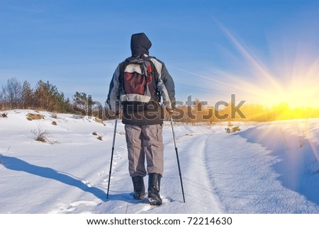 hiker on a winter road