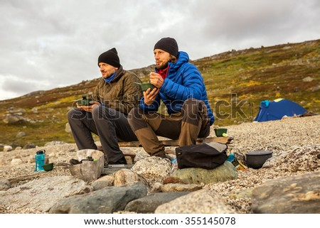 Hiker on the Camp in the evening - stock photo
