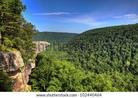 Hiker on the famous Hawksbill Crag in Arkansas. - stock photo