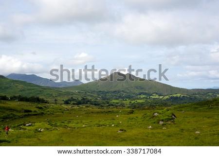 hiker on the kerry way in irelands wild atlantic way - stock photo