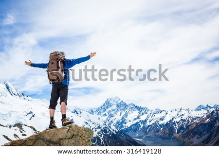 Hiker on the mountain top. Sport and active life concept. New Zealand. Mountain Cook