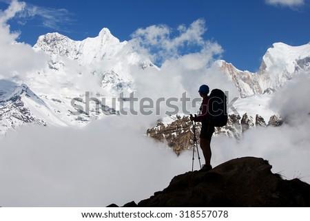Hiker on the trek in Himalayas, Annapurna valley, Nepal - stock photo