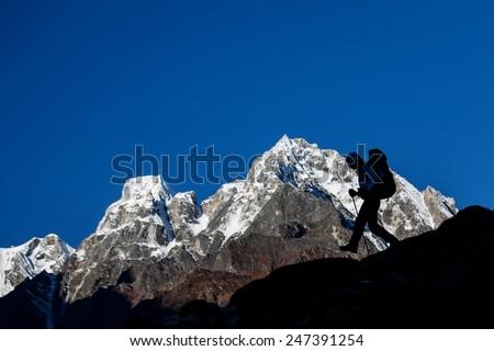 Hiker on the trek in Himalayas, Manaslu region, Nepal - stock photo