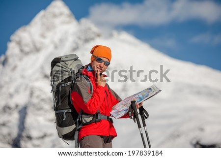 Hiker posing in Himalayas in front of big mountains - stock photo
