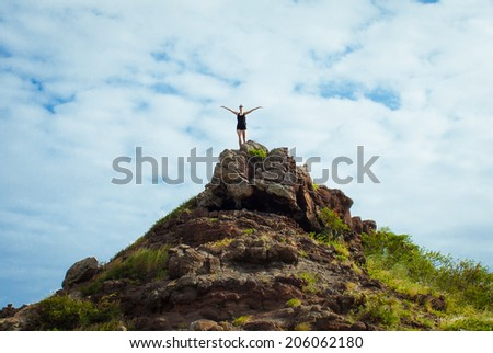 Hiker reaching the top of the mountain. - stock photo