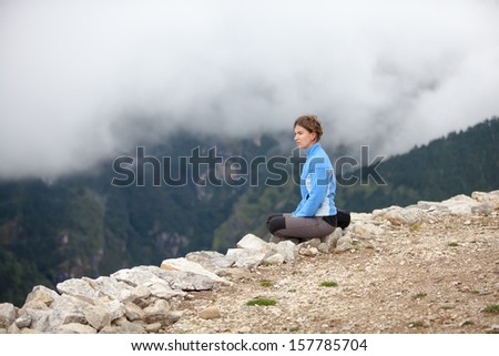 Hiker rests on the trek in Himalayas, Nepal