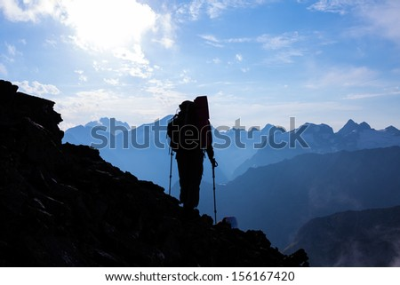 hiker silhouette on a mountain slope