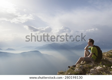 Hiker sitting to view beautiful landscape - stock photo