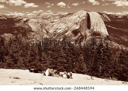 Hiker take a rest at Half Dome in Yosemite National Park. - stock photo