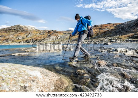 Hiker takes a River in northern Sweden