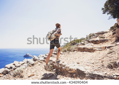 Hiker traveler girl on a hiking trail, travel and active lifestyle concept - stock photo
