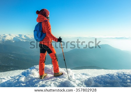 Hiker trekking in the winter mountains. Sport and active life - stock photo