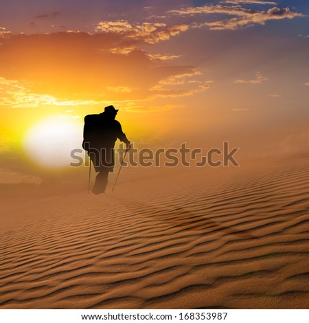 hiker walk through a sand desert