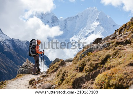Hiker walks on train in Himalayas