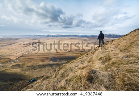 Hiker watching over a stunning landscape.