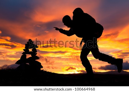 hiker with Backpack and amazing sunrise - stock photo