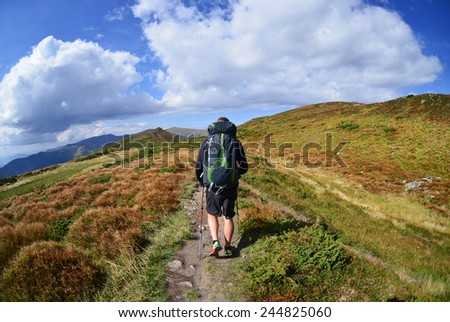 Hiker with backpack  in the mountains,Carpathian ,Ukraine - stock photo