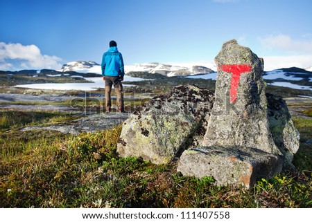 Hiker with hiking signs in Norway - Hardangervidda - stock photo