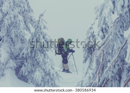 Hiker with snowshoes in winter. Instagram filter. - stock photo