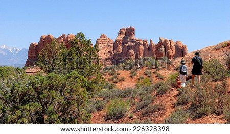 Hikers at Arches National Park in Utah, USA - stock photo
