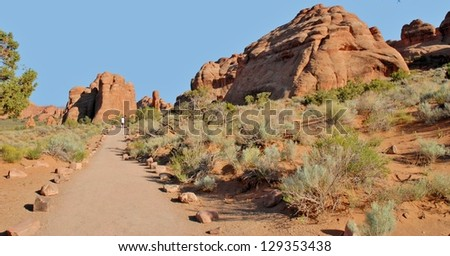 Hikers at Devil's Garden, Arches National Park in Utah, USA - stock photo