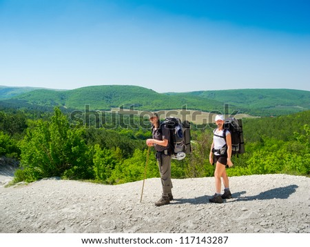 Hikers couple on a path in Crimea mountains