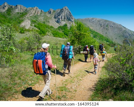 Hikers group trekking in Crimea mountains - stock photo