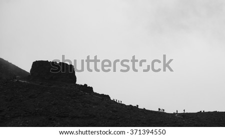 Hikers hiking up to the Red Crater on the Tongariro Crossing - stock photo