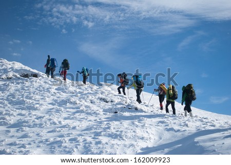 hikers in a winter mountain