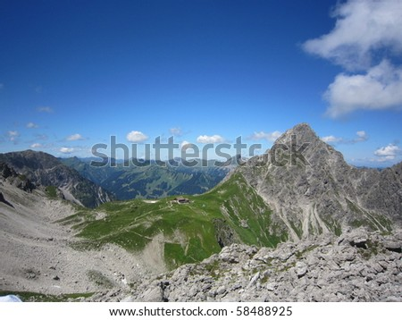 Hikers in mountains - stock photo