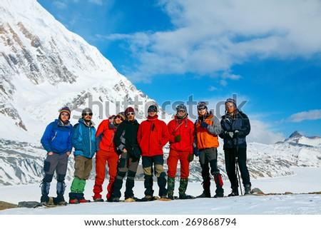hikers in the Hamalayas mountains. Trek around Annapurna mount, Tilicho lake. - stock photo