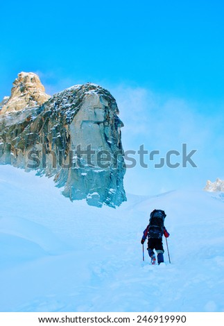 Hikers in winter mountains - stock photo