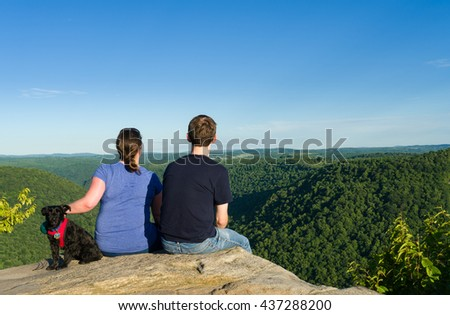 Hikers look at Cheat River Canyon from Raven Rock in Coopers Rock State Forest West Virginia