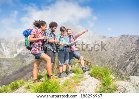 Hikers Looking at Map on top of Mountain