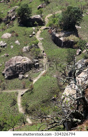 Hikers make their way along a hiking trail in the Drakensberg mountain range in rural KwaZulu-Natal, South Africa.