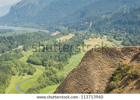 Hikers on a Mountain overlooking Columbia River Gorge - stock photo