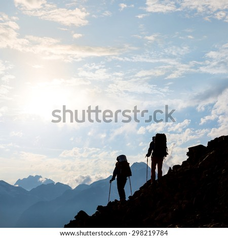 hikers on a mountain slope - stock photo