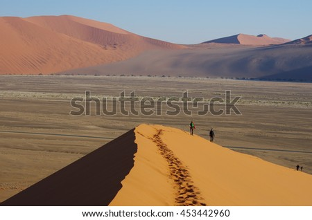 Hikers on the dunes, Namibia