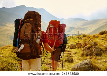hikers on the trail in the Caucasian mountains. Trek to Kazbek mount - stock photo