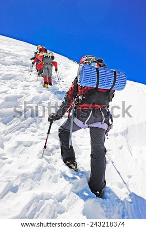 Hikers on the trek in Himalayas - stock photo