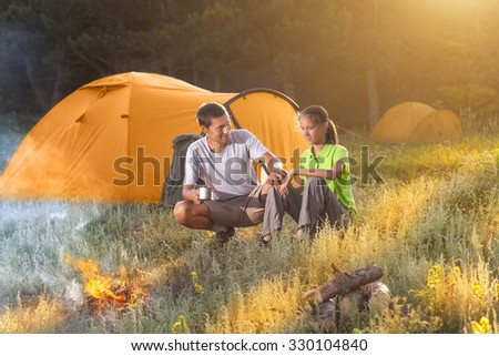 Hikers resting at the camping. - stock photo