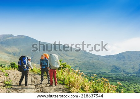 Hikers team and mountain landscape