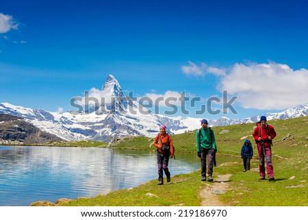 hikers team in the mountains. Matterhorn. Swiss Alps  - stock photo