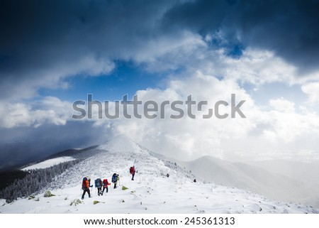 hikers team in winter mountains. Sport lifestyle travel concept