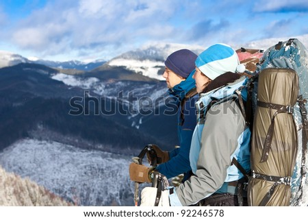 HIkers team resting enjoying a break during hike vacation - stock photo