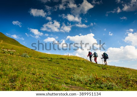 hikers walking in the mountains. goal, success, freedom and happiness, achievement in the mountains - stock photo