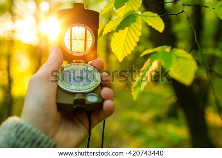 Hiking Adventure with Compact Compass. Looking For the Right Way To Go. Forest Hiker - stock photo