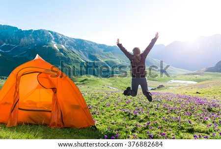 hiking and camping in mountains - stock photo