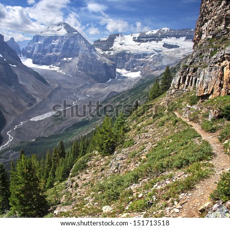 Hiking at Lake Louise, Banff National Park, Alberta, Canada The view looking from left to right, Mount Lefroy, Victoria. The trail to the Devil's Thumb, a protrusion of Mount Whyte.  - stock photo