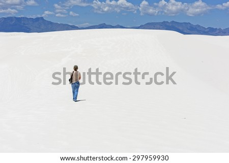 Hiking at White Sands National Monument after a light rain storm - stock photo